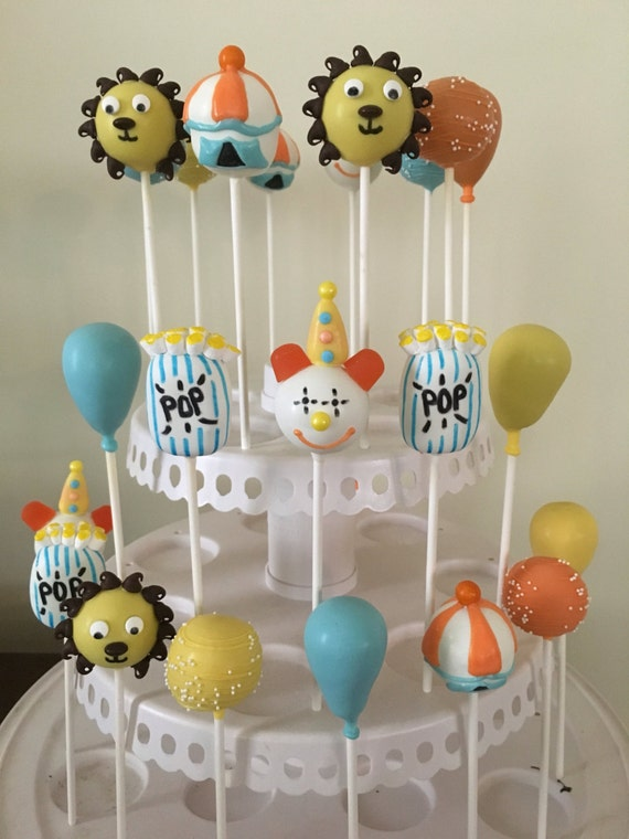 baby shower circus themed cake pops blue green and yellow clown