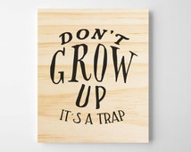 Don't Grow Up, It's a Trap Nursery Wall Art. Kids Room Art. Inspirational quote. Wooden Sign. Wall Decor. Baby room decor. Baby gift