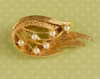 Gold tone and pearl bead wing brooch