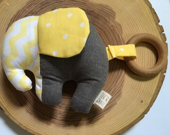 Yellow, white, and grey polka dot and chevron cotton elephant teething toy with maple wood teething ring