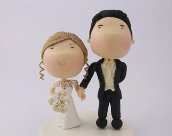 Couple holding hands. Wedding cake topper. Wedding figurine. Handmade. Fully customizable. Unique keepsake