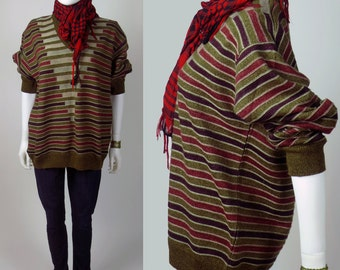 70s jacquard knit engineered striped geometric v-neck oversize gamine wool blend cosby sweater