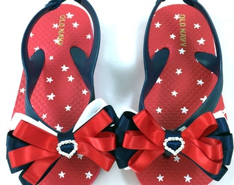 Custom Bling Toddler Star Flip Flops with custom Red, White and Blue Satin Loopy Ribbon Bows and Rhinestone Heart Slider