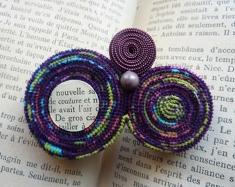 Pin fabric rolls, small button and cabochon book page -