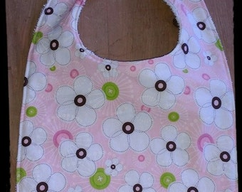 Bib pink flowers and button