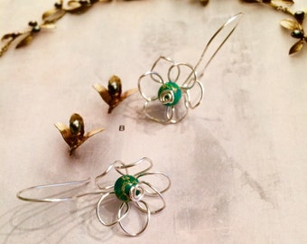Handmade silver wire flower earrings with green howlite beads
