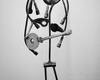 Recycled metal sculpture of a banjo player
