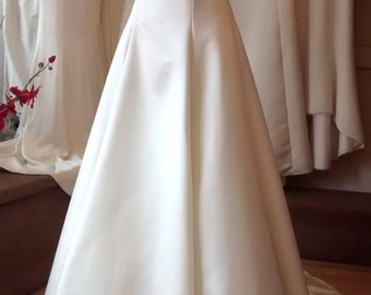 Duchess satin wedding dress with lace trim detail