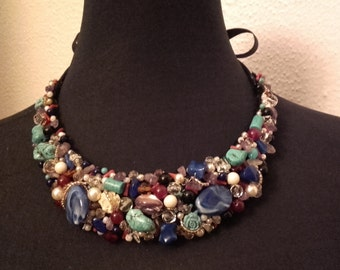 Lovely bib necklace. Made with semi-precious stones and synthetic