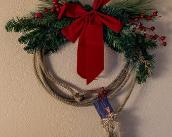 Rope wreath with red bow and berries