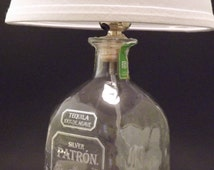 Patron bottle lamp base with toggle switch