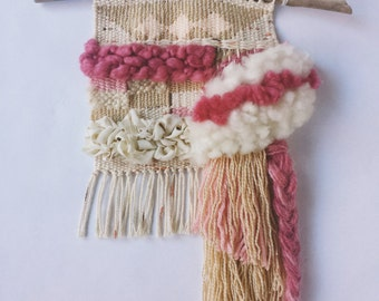 "Woven Wall Hanging // pastel weaving with fringe and braids. Pink, gold, cream, and white. Textured, art yarn, linen ""Soft Offering"""