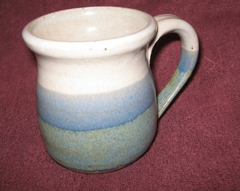 White and Turquoise Stoneware Cup