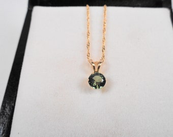 Sapphire Necklace.  Natural 4.5mm. Sapphire Oval with a 18kt. Gold 18 inch Chain.
