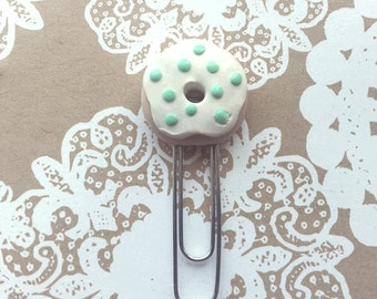 Donut topped with white frosting and mint sprinkles paperclip!