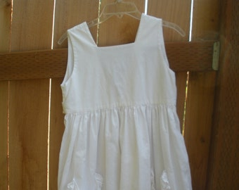 white cotton pinafore dress,  girls size,  34inches  shoulder to hem.