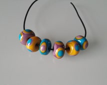 Group of six lampwork beads handcrafted Murano glass mustard yellow,violet,blue with concentric points