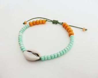Bracelet with shell, beads green water, orange wooden beads.  Summer bracelet, beach bracelet.