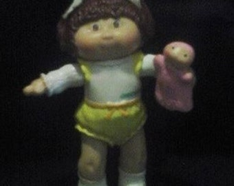 Vintage CABBAGE PATCH Kid PVC figurine with baby doll