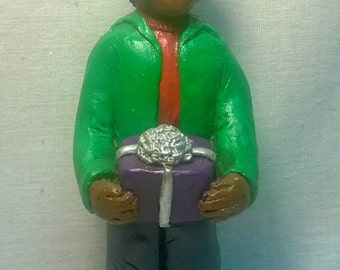 "Handpainted "" Boy Holding Gift"" Figurine"