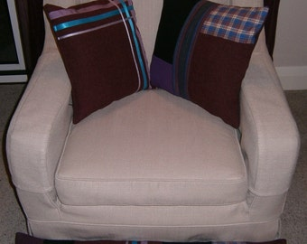 Two handmade co-ordinating cushions with draught excluder in purple
