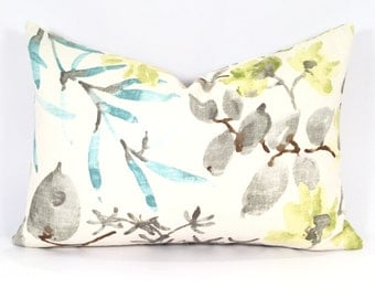 Airy Botanical Throw Pillow Cover in Bright Avocado Green, Blue & Brown on a White Linen Background