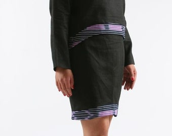 set in linen with cotton kita empievements. asymmetrical neckline