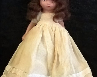 Full Bisque Nancy Ann Storybook Doll with cream dress