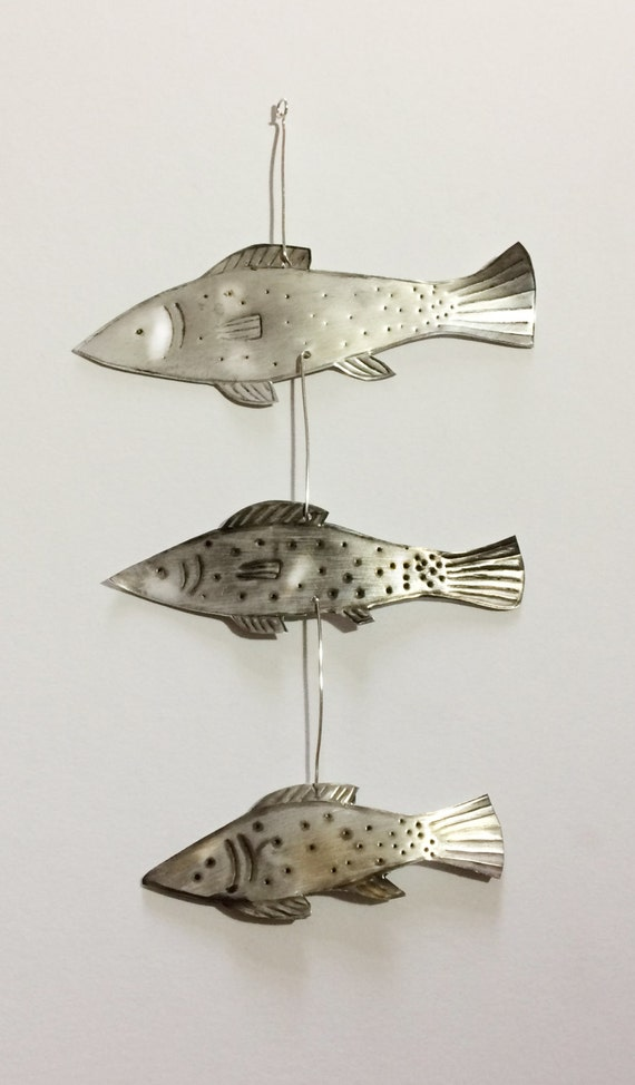 Hanging with three silver fish
