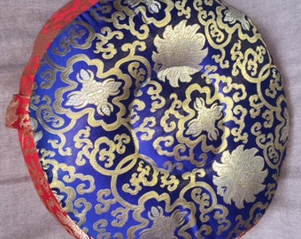 Cobalt blue and red meditation cushion, silk trim with cotton fill, gold intricate designs 15 inches round, 5 inches depth, 5 lbs.