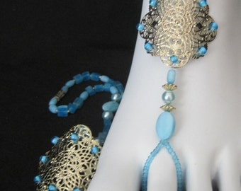 Very Pretty Blue with Flat Pearls and square beads. The center is a finished Gold with woven beads on the edges.