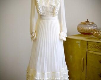 Vintage 1960s edwardian style Pronuptia wedding dress, extremely pretty retro style, cream ruffle detail, long sleeves, pleated skirt
