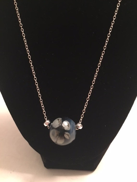 Blue Venetian style blown glass hollow bead strung on sterling silver
