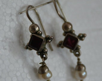 Sterling pierced earrings with garnets and a hanging seed pearl