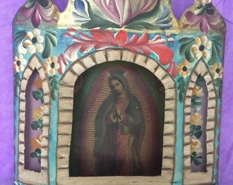 Virgin of Guadalupe behind glass with hand painted tin