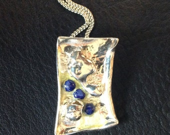 Silver and lapis pendant