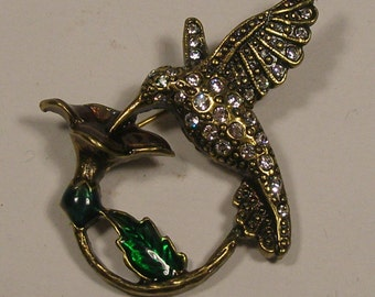 Vintage hummingbird and lily flower brooch