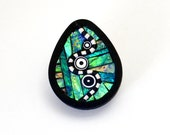 Pin brooch pendant necklace tear drop shape polymer clay iridescent green blue colors black and white elements