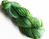 sprout / hand dyed yarn / superwash merino wool / dk weight yarn / light worsted weight / single-ply / single yarn / grass green yarn / ply
