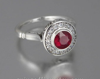 The SECRET DELIGHT 14k gold Ruby engagement ring with diamond halo