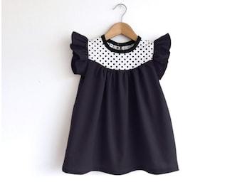 girls black cotton dress with dots detail