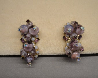 Vintage Clip Back Alice Caviness 1950's earrings, Prong set rhinestones, Lighter shades of purple, Three dimensional semi crescent shape