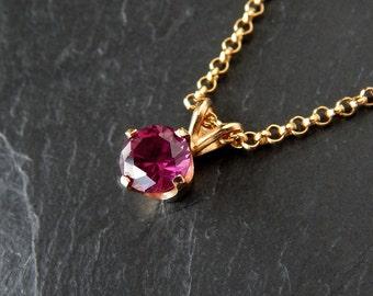 Raspberry Red Rhodolite Pendant: 14k yellow gold, genuine wine red garnet, 6.6mm round, 16 inch long rolo chain, January birthstone necklace
