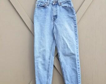 80s vintage Levi's 512 Light Wash Distressed High Waist Slim Fit Tapered leg Jeans
