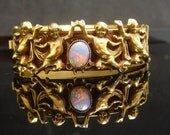 Antique bracelet Opal haunted Angels Hinged gold Bangle medieval Italian putti Victorian Renaissance Queen