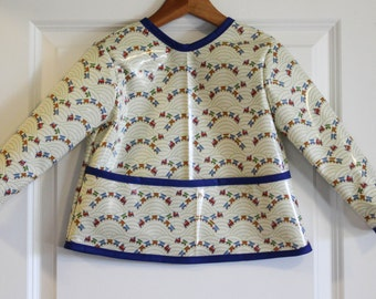 LAST ONE Toddler 2/3 Long Sleeved Art Smock Baby Bib in Cream with Trains