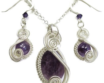 "Dark Amethyst and Sterling Silver Necklace and Earrings Set; ""Swish"" Style"