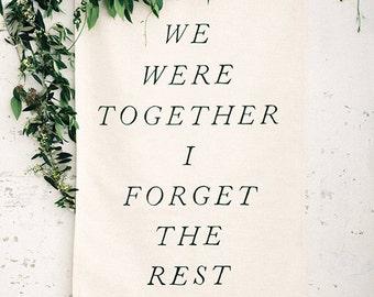 """Linen backdrop. """"We Were Together, I Forget The Rest."""" Wedding banner."""