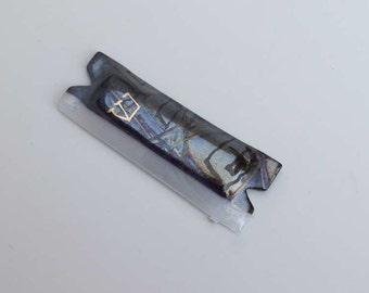 Black and white fused glass mezuzah case with hand-painted Hebrew shin