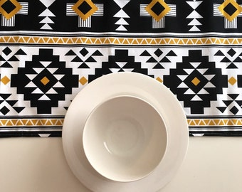 Table runner, Tribal Aztec Southwestern Navajo print, geometric. Riley Blake. Black, white and gold.  Measures 13 inches x 72 inches. Cotton